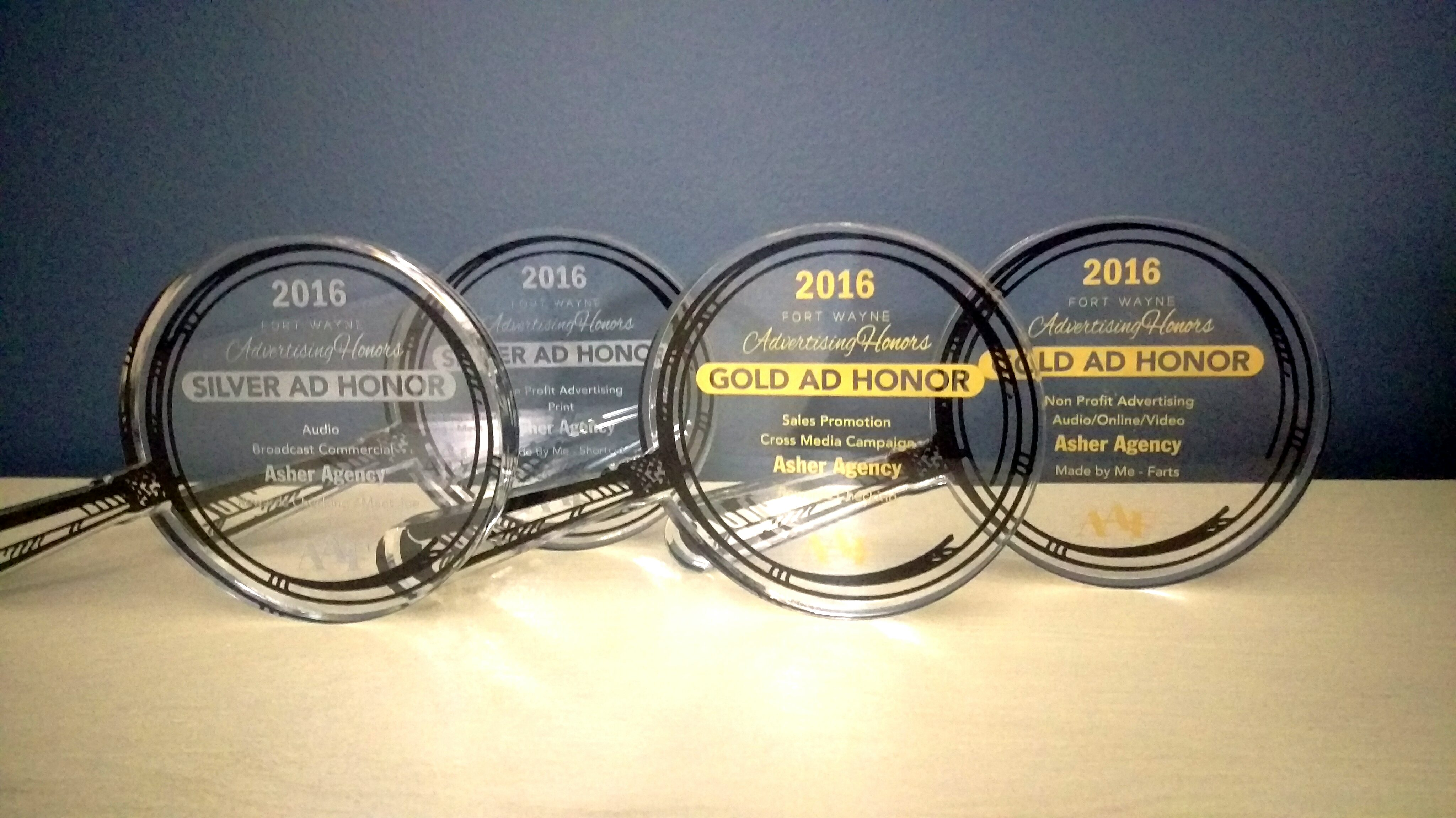 Asher takes home 16 awards at annual Advertising Honors competition.